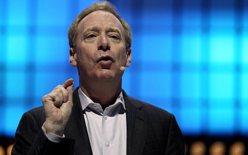 Microsoft's President Brad Smith speaks at the Web Summit in Lisbon in 2019 - Pedro Nunes/Reuters