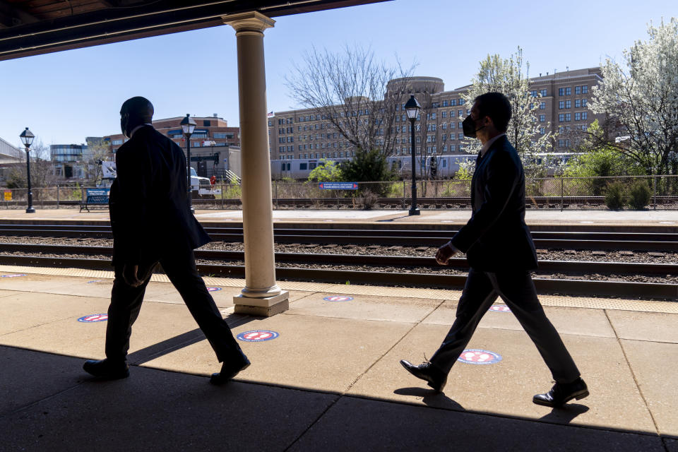 FILE - In this March 30, 2021, file photo Transportation Secretary Pete Buttigieg, right, departs a news conference to announce the expansion of commuter rail in Virginia at the Amtrak and Virginia Railway Express (VRE) Alexandria Station in Alexandria, Va. (AP Photo/Andrew Harnik, File)