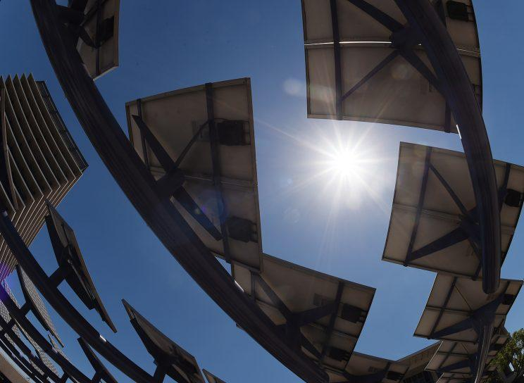 The sun shines on solar panels outside an office building in Los Angeles in 2015.