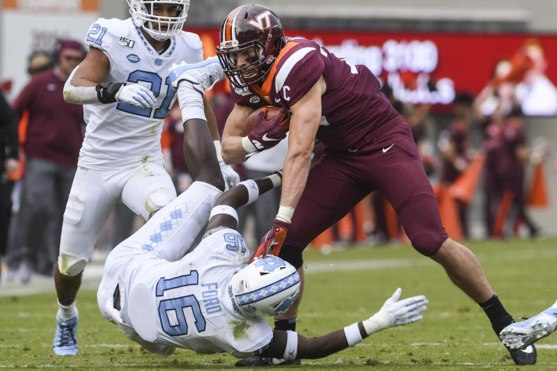 BLACKSBURG, VA - OCTOBER 19: Tight end Dalton Keene #29 of the Virginia Tech Hokies stiff arms defensive back D.J. Ford #16 of the North Carolina Tar Heels in the first half at Lane Stadium on October 19, 2019 in Blacksburg, Virginia. (Photo by Michael Shroyer/Getty Images)