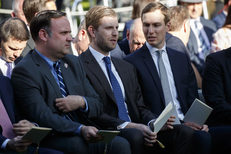 White House Social Media Director Dan Scavino, left, Eric Trump, center, and White House senior adviser Jared Kushner wait for the arrival of President Donald Trump to present golfer Tiger Woods with the Presidential Medal of Freedom, in the Rose Garden of the White House, Monday, May 6, 2019, in Washington. (AP Photo/Evan Vucci)