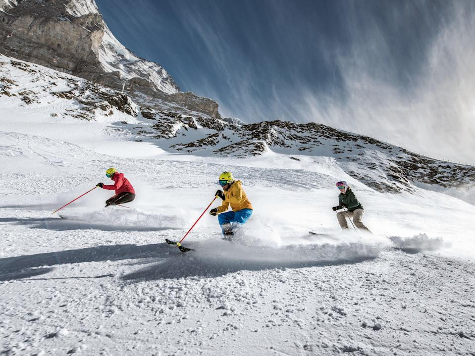 <p>Skiers in Jungfrau.  Resorts are going green to reduce their impact</p> (Jungfrau)