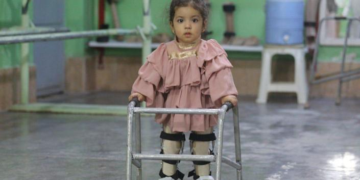 A physically disabled girl walks with a walker at the physically disabled center of the International Committee of the Red Cross in Herat, Afghanistan on September 02, 2021. The center is the only disability support center in Afghanistan.