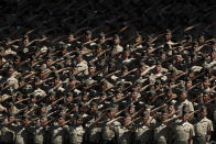 Recruits from Marine Corps Recruit Depot San Diego salute during the national anthem before a baseball game between the San Diego Padres and the Colorado Rockies, Sunday, Sept. 8, 2019, in San Diego. (AP Photo/Gregory Bull)
