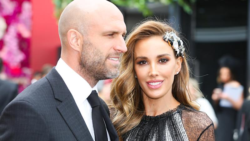 Chris and Rebecca Judd, pictured here at Derby Day at the 2018 Melbourne Cup Carnival.