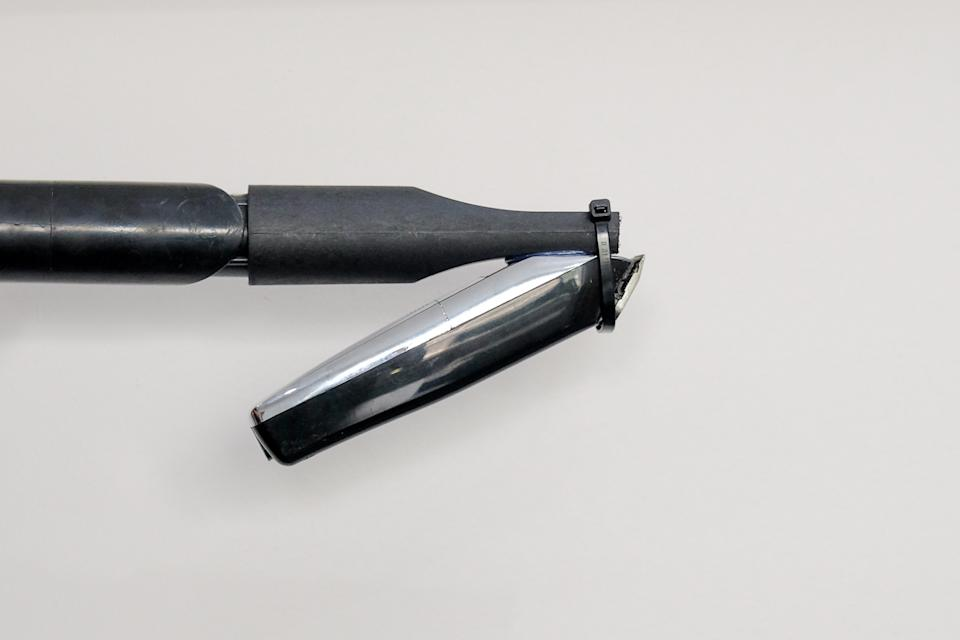 The simple creation enables users to cut their own hair with one hand. (SWNS)