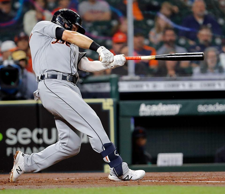 Robbie Grossman of the Detroit Tigers hits an RBI single in the second inning against the Houston Astros at Minute Maid Park on April 14, 2021 in Houston, Texas.