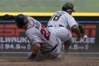 Atlanta Braves' Austin Riley is safe at second as Milwaukee Brewers' Kolten Wong can't handle the throw during the eighth inning of a baseball game Sunday, May 16, 2021, in Milwaukee. (AP Photo/Morry Gash)