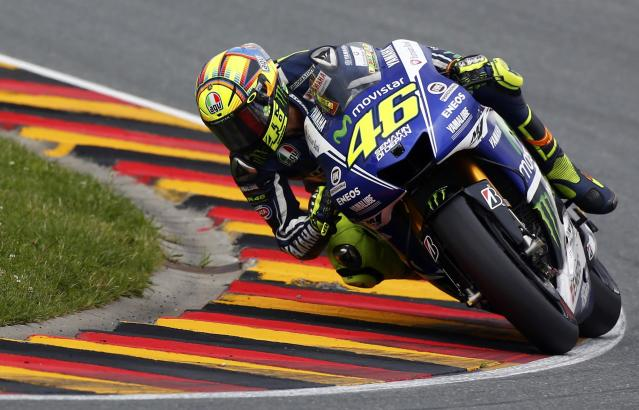 Yamaha Moto GP rider Valentino Rossi of Italy competes during the German Grand Prix at the Sachsenring circuit in the eastern German town of Hohenstein-Ernstthal July 13, 2014. REUTERS/Thomas Peter (GERMANY - Tags: SPORT MOTORSPORT)