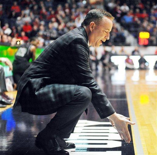 Texas A&M head coach Billy Kennedy talks to an official about a Mississippi player during an NCAA college basketball game against Texas A&M's in Oxford, Miss. on Wednesday, Feb. 27, 2013. (AP Photo/Oxford Eagle, Bruce Newman)
