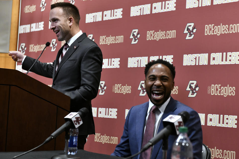 Jeff Hafley (L) and BC athletic director Martin Jarmond smile during a news conference where Hafley was introduced on Monday. (AP)