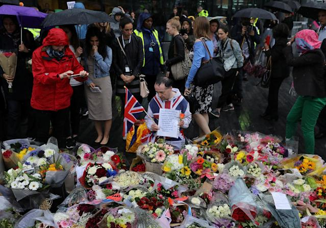 <p>People look at floral tributes after a vigil to remember the victims of the attack on London Bridge and Borough Market, at Potters Field Park, in central London, Britain, June 5, 2017. (Photo: Marko Djurica/Reuters) </p>