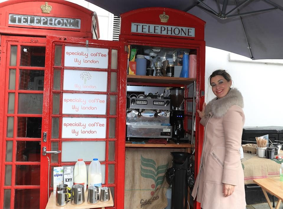 <p>Lily Deluca, from Sao Paolo, who has found her calling during the Covid-19 pandemic after turning a red phone box into a mini coffee kiosk on Tunsgate in Guildford, Surrey. Lily purchased the booth on Tunsgate in Guildford, Surrey, with friend Achilleas Papakitsos last year before opening her new business, Lily London, in December. Picture date: Monday February 15, 2021. (Photo by Adam Davy/PA Images via Getty Images)</p>