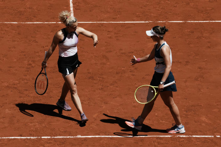 Czech Republic's Barbora Krejcikova,right, and compatriot Katerina Siniakova celebrate winning a point as they play USA's Bethanie Mattek-Sands and Poland's Iga Swiatek during their women's doubles final match of the French Open tennis tournament at the Roland Garros stadium Sunday, June 13, 2021 in Paris. (AP Photo/Thibault Camus)