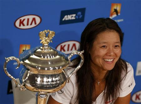 Li Na of China attends a news conference after winning her women's singles final match against Dominika Cibulkova of Slovakia at the Australian Open 2014 tennis tournament in Melbourne January 25, 2014. REUTERS/Bobby Yip