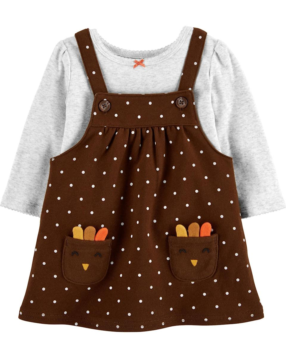 """<p><strong>OshKosh B'gosh</strong></p><p>oshkosh.com</p><p><strong>$16.80</strong></p><p><a href=""""https://go.redirectingat.com?id=74968X1596630&url=https%3A%2F%2Fwww.oshkosh.com%2Fcarters-baby-girl-dresses%2FV_1J258110.html&sref=https%3A%2F%2Fwww.goodhousekeeping.com%2Fholidays%2Fthanksgiving-ideas%2Fg23100250%2Fbest-baby-thanksgiving-outfits%2F"""" rel=""""nofollow noopener"""" target=""""_blank"""" data-ylk=""""slk:Shop Now"""" class=""""link rapid-noclick-resp"""">Shop Now</a></p><p>You get two pieces with this outfit: the jumper, and the bodysuit underneath. The happy turkey pockets are just the right amount of Thanksgiving.</p>"""
