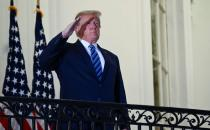 U.S. President Donald Trump poses without face mask as he returns to the White House after being hospitalized at Walter Reed Medical Center for coronavirus disease (COVID-19), in Washington
