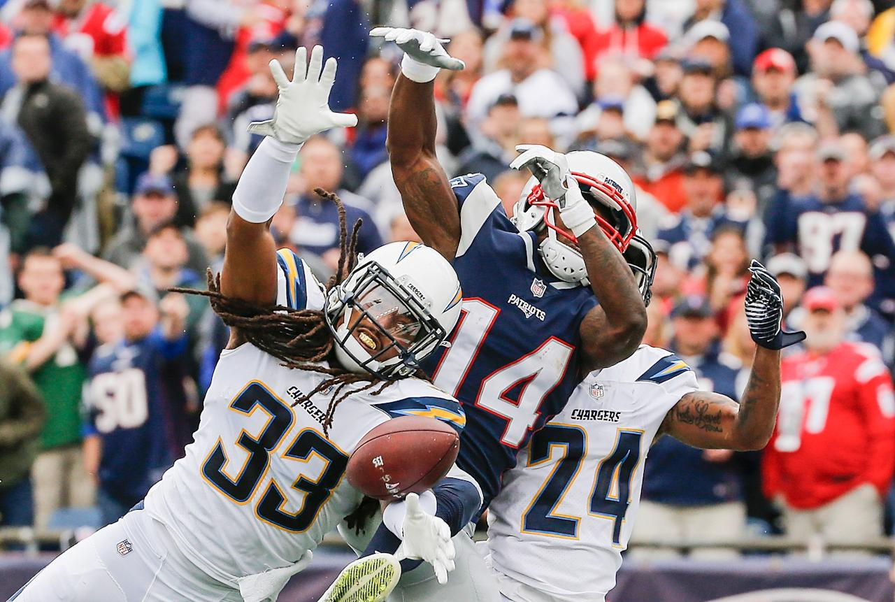 <p>Tre Boston #33 of the Los Angeles Chargers blocks a pass intended for Brandin Cooks #14 of the New England Patriots during the second quarter of a game at Gillette Stadium on October 29, 2017 in Foxboro, Massachusetts. (Photo by Jim Rogash/Getty Images) </p>