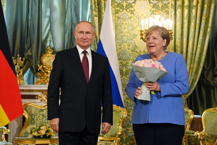 German Chancellor Angela Merkel, right, and Russian President Vladimir Putin smile during their meeting in the Kremlin in Moscow, Russia, Friday, Aug. 20, 2021. The talks between Merkel and Putin are expected to focus on Afghanistan, the Ukrainian crisis and the situation in Belarus among other issues. (Sputnik, Kremlin Pool Photo via AP)