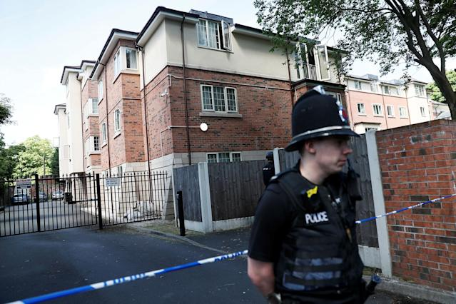 <p>Police officers stand outside a residential property near to where a man was arrested in the Chorlton area of Manchester, Britain on May 23, 2017. (Stefan Wermuth/Reuters) </p>