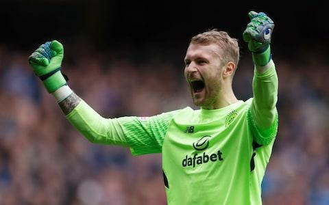 "Scott Bain knows what it means to be out in the cold – literally and figuratively – which is why he has savoured the warmth of fan approval since his unexpected contribution to the drama of Celtic's 3-2 victory over Rangers in the Old Firm league derby at Ibrox earlier this month. Bain was pitchforked into his Celtic debut because of a training injury sustained by Dorus de Vries, who had been deputising for Craig Gordon, victim of a long-term knee problem. The third-choice keeper, who joined from Dundee in January after a loan deal with Hibernian fell through, had to retrieve the ball from his net within two minutes, after an error by Dedryck Boyata. Bain, though, made crucial saves from Alfredo Morelos shots to contribute to a winning performance by a Celtic side depleted by the second-half dismissal of Jozo Simunovic. At that point, life was transformed for the affable 26-year-old. ""It's been mad, really. I stay in Edinburgh and it's not as big as it is in Glasgow, but even through there a lot of people recognise you, stop and speak to you,"" Bain said. New job: Scott Bain celebrates after Tom Rogic scores Credit: Reuters ""Obviously, social media's a big thing now too. The support I've had from the fans has been incredible."" Bain's new-found celebrity status was not only aided by the misfortunes of De Vries and Gordon but also by an unforeseen end to his spell with Dundee, after an otherwise unremarkable three-and-a-half-year spell at Dens Park. After Dundee lost 3-1 at home to Hamilton on October 28, Neil McCann dropped Bain and fined the player two weeks' wages. Bain refused to pay and appealed to PFA Scotland for backing in a dispute that was ongoing when the goalkeeper first moved on loan to Hibs and then, at the end of the January transfer window, to Celtic. At that stage, he was simply trying to get out of an untenable season and his most likely prospect at Celtic was of making up the numbers. Go out there and give them hell: Scott Bain gets some last-minute instructions Credit: Getty ""It did go through my mind a bit,"" Bain said. ""When you first come to a club this size from the situation I was in, it's going to go through your head, but they wanted me to come and that was a big confidence boost. ""It was difficult at Dundee. I'm not going to lie. I thought if I'm still at Dundee then it's going to be hard to get another club, because you're forgotten about quickly in football. ""It was always going to be hard to get in to the team with goalkeepers like Dorus and Craig, but once you get your chance you just need to enjoy it and try to take it."" That was a lesson Bain absorbed much earlier in his career, when he was a part-timer with Alloa Athletic and worked on a house building project with his father, a joiner. ""I used to work from eight to four, Monday to Friday, but on a Tuesday and Thursday I'd also go to Alloa and train from seven to half nine,"" he said. Welcome addition: Brendan Rodgers is delighted with his new keeper Credit: Getty Images Europe ""I'd be back home about half past 10, go to sleep and up the next day for an eight to four shift. I was a labourer for the first year and the second year I helped two boys out with building kits for houses and I really enjoyed it - apart from the winter. ""The worst point was when the forklift driver brought over a pallet of plasterboard sheets and there were 72 sheets on a pallet. I loaded them into the house and I thought I was done for the day. Then the forklift driver told me there were another four pallets-full to be sorted. ""At that point I'm thinking 'Nah, this isn't for me.' ""I actually loaded the flat I'm in now with plasterboard sheets. So, I can go around and tell them what I think of the joinery work and get my dad to fix any problems."" Warm welcome: Bain is on his way to being a popular figure at Parkhead Credit: Retuers Brendan Rodgers, meanwhile, has found that the Celtic squad had acquired a complementary character. ""He's a very grounded personality - I really can't imagine ever falling out with him, put it that way,"" the manager said. ""His first game for us at Ibrox was a wonderful demonstration of personality, technique, composure under pressure plus he obviously makes saves. ""His story is fabulous - from working on a building site to this. When you think about it, to turn up and sign for us while wearing another club's tracksuit - when I saw that I thought, 'Well, it could have been plasterboards and a trowel…' ""These last couple of games have shown our supporters that, goodness me, he's a really good keeper. He's a joy to work with, always smiling and, while he has great humility, he's also not intimidated in any way. I've been delighted for him."""