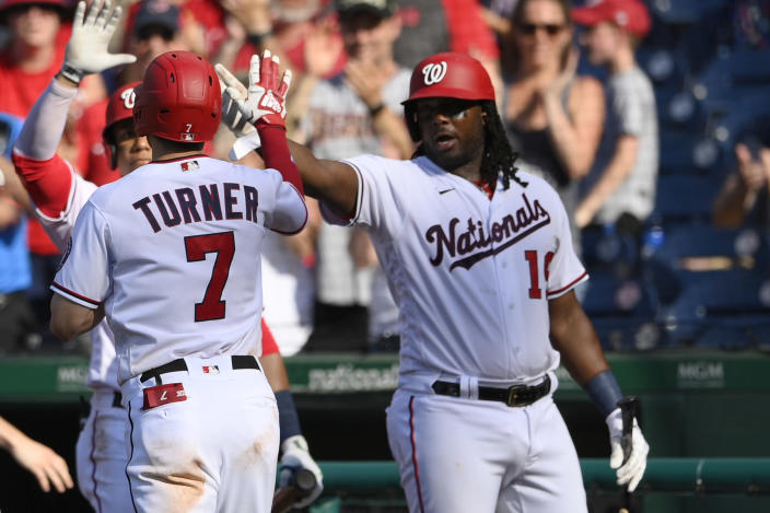 Washington Nationals' Trea Turner (7) celebrates his home run with Josh Bell, right, during the fourth inning of the team's baseball game against the Tampa Bay Rays, Wednesday, June 30, 2021, in Washington. (AP Photo/Nick Wass)