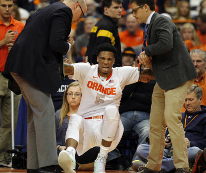 Syracuse's Chris McCullough is helped off the court after being injured. (AP)