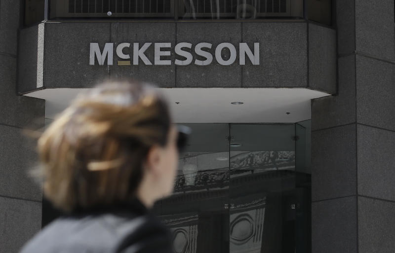 A pedestrian walks across the street from a McKesson sign on an office building in San Francisco, Wednesday, July 17, 2019. Newly released federal data shows how drugmakers and distributors increased shipments of opioid painkillers across the U.S. as the nation's addiction crisis accelerated from 2006 to 2012. McKesson distributed more than 18% of the nation's opioids from 2006 to 2012 — the most of any company — but said it didn't push sales. (AP Photo/Jeff Chiu)