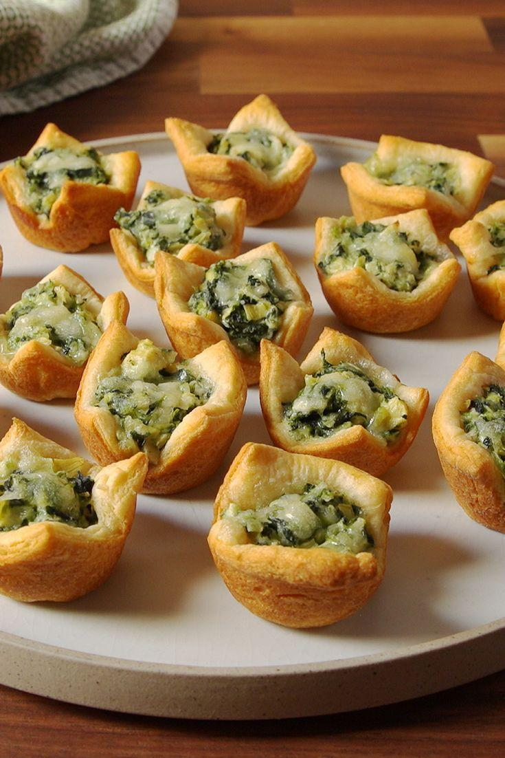 """<p>Your favorite dip, now in adorable, bite-size form.</p><p>Get the recipe from <a href=""""https://www.delish.com/cooking/recipe-ideas/recipes/a50688/spinach-artichoke-cups-recipe/"""" rel=""""nofollow noopener"""" target=""""_blank"""" data-ylk=""""slk:Delish"""" class=""""link rapid-noclick-resp"""">Delish</a>.</p>"""