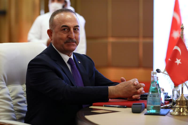 FILE PHOTO: Turkey's Foreign Minister Mevlut Cavusoglu attends a meeting with Qatar's Deputy Prime Minister and Minister of Foreign Affairs Mohammed bin Abdulrahman Al Thani and Russia's Foreign Minister Sergei Lavrov in Doha