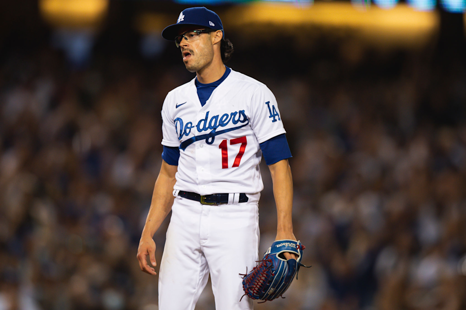 Dodgers relief pitcher Joe Kelly reacts after striking out San Diego's Tommy Pham in the eighth inning.