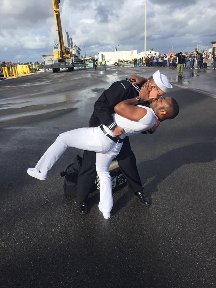 Kenneth and Bryan Woodington shared their first kiss in seven months since Bryan's deployment, re-creating an iconic kiss in Times Square, N.Y. (Photo: Facebook/Naval Station Mayport)