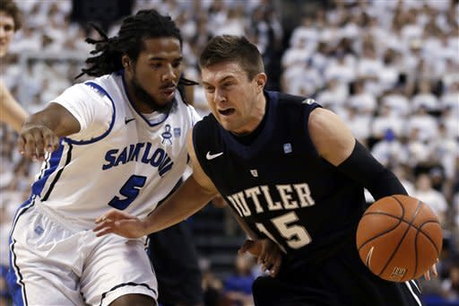 Butler's Rotnei Clarke, right, dribbles around Saint Louis' Jordair Jett during the first half of an NCAA college basketball game Thursday, Jan. 31, 2013, in St. Louis. (AP Photo/Jeff Roberson)