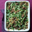 """<p>Elevate your typical green bean casserole with some crispy sausage.<br></p><p><em><a href=""""https://www.womansday.com/food-recipes/food-drinks/recipes/a11465/green-bean-casserole-crispy-sausage-recipe-wdy1113/"""" rel=""""nofollow noopener"""" target=""""_blank"""" data-ylk=""""slk:Get the Green Bean Casserole with Crispy Sausage recipe."""" class=""""link rapid-noclick-resp""""><strong>Get the Green Bean Casserole with Crispy Sausage recipe.</strong></a></em></p>"""