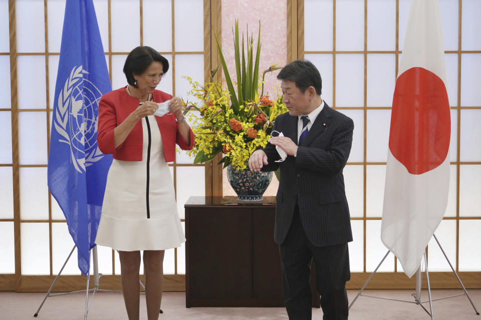 United Nations Secretary General's Special Envoy to Myanmar Christine Schraner Burgener, left, and Japan's Foreign Minister Toshimitsu Motegi pose for media during a courtesy call at the Ministry of Foreign Affairs Friday, May 28, 2021, in Tokyo. (AP Photo/Eugene Hoshiko, POOL)