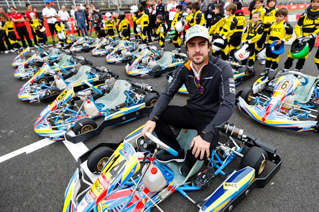Kart man: Fernando Alonso goes back to his racing roots at the Barcelona circuit. Bet he can bring that kart home in the points despite its lack of power etc etc