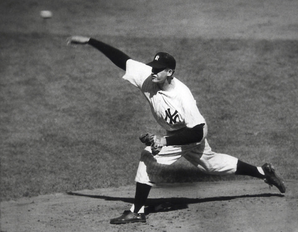 FILE - In this Oct. 8, 1956, file photo, New York Yankees' Don Larsen delivers a pitch in the fourth inning of Game 5 against the Brooklyn Dodgers in the baseball World Series en route to the first World Series perfect game. The Yankees won 2-0 and went on to win the series. Larsen, the journeyman pitcher who reached the heights of baseball glory in 1956 for the Yankees when he threw a perfect game and the only no-hitter in World Series history, died Wednesday night, Jan. 1, 2020. He was 90. (AP Photo, File)