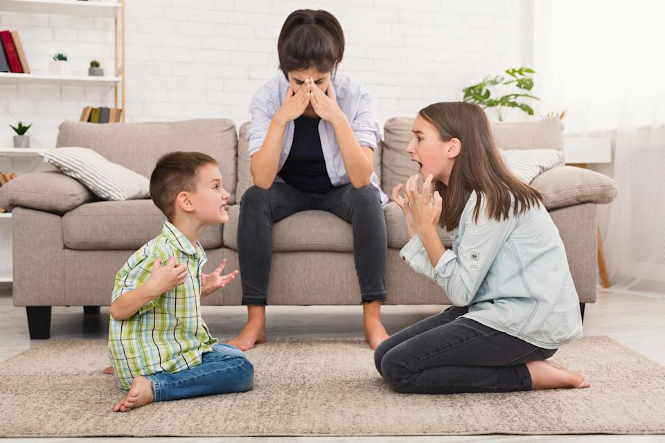 Help your kids manage conflict instead of solving it for them. (Photo: Getty)