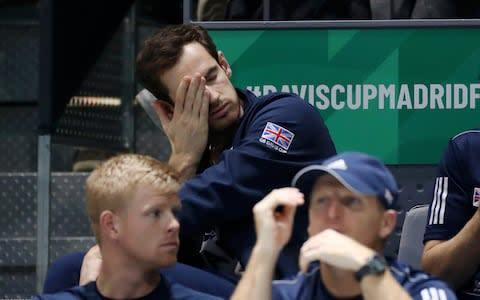 <span>Andy Murray is dejected as he looks on from the stands</span> <span>Credit: Getty Images </span>