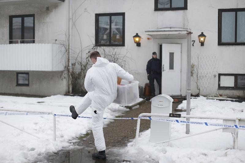 Police investigators outside a home for juvenile asylum seekers in Molndal, southwestern Sweden on January 25, 2016