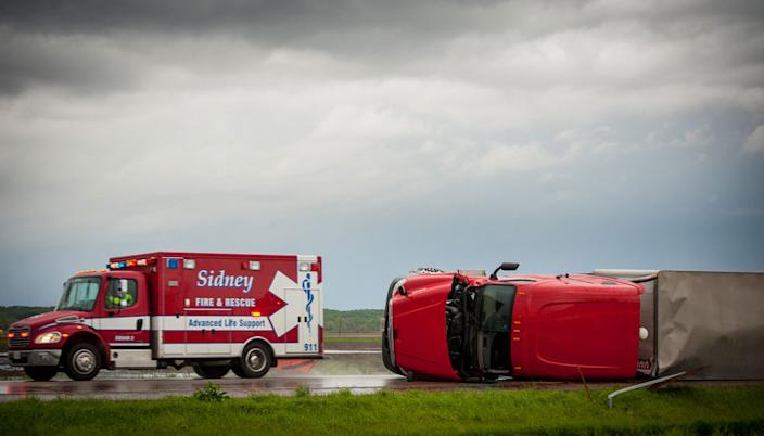 THURMAN, IA - APRIL 14: Several Semi trucks and their trailers are overturned on Interstate 29 April 14, 2012 in Thurman, Iowa. The storms were part of a massive system that affected areas from Northern Nebraska south through Oklahoma.