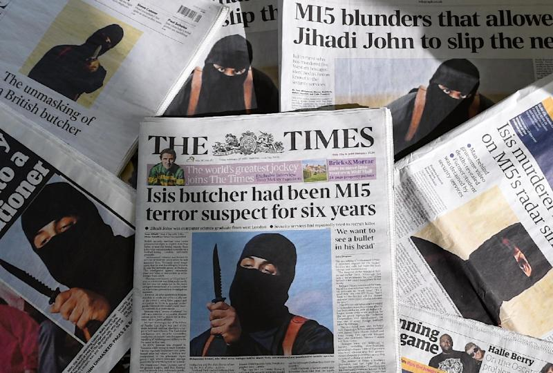 """British daily newspapers showing front-page headlines and stories regarding the identification of the masked Islamic State group militant dubbed """"Jihadi John"""", on February 27, 2015 (AFP Photo/)"""