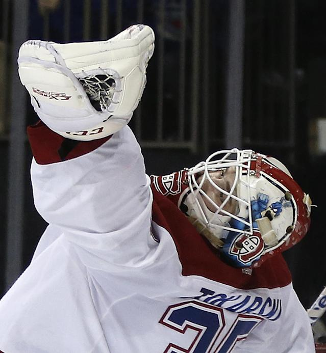Montreal Canadiens goalie Dustin Tokarski (35) grabs a shot by the New York Rangers in his glove during the second period in Game 6 of the NHL hockey Stanley Cup playoffs Eastern Conference finals, Thursday, May 29, 2014, in New York. (AP Photo/Kathy Willens)