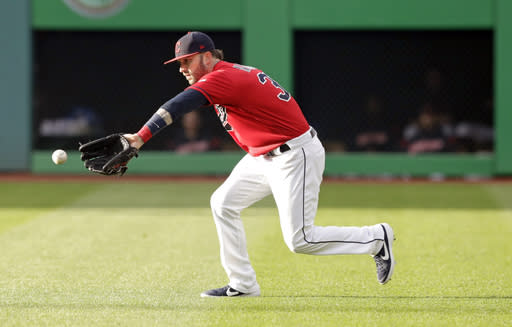 Cleveland Indians' Tyler Naquin fields a ball hit by Miami Marlins' Brian Anderson in the fourth inning of a baseball game, Tuesday, April 23, 2019, in Cleveland. Anderson was safe at first base. (AP Photo/Tony Dejak)