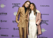 "FILE - Actresses Evan Rachel Wood, left, and Gina Rodriguez attend the premiere of ""Kajillionaire"" during the 2020 Sundance Film Festival in Park City, Utah on Jan. 25, 2020. The film is about a family of grifters in Los Angeles. (Photo by Arthur Mola/Invision/AP, File)"