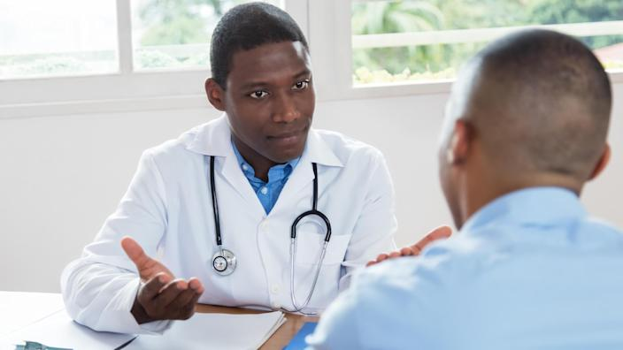 Internist discussing results with a patient