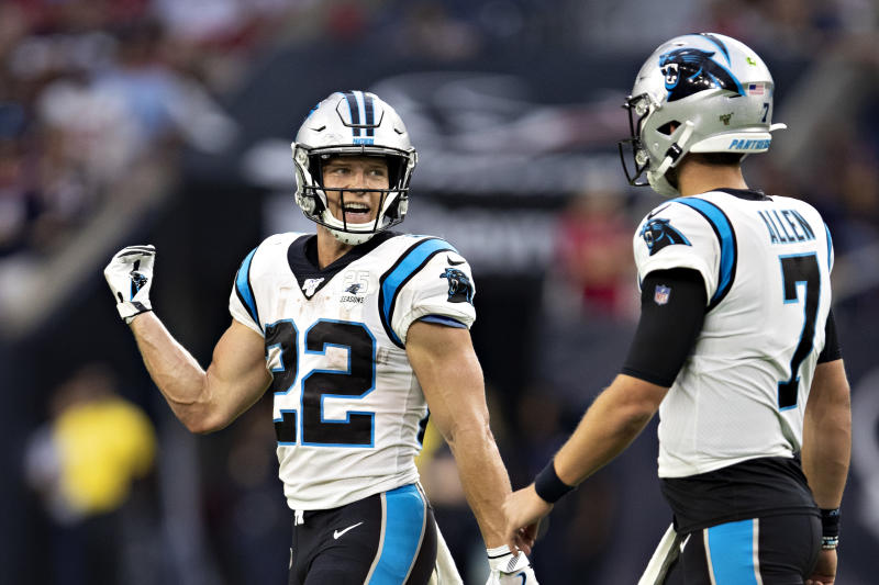 HOUSTON, TX - SEPTEMBER 29: Christian McCaffrey #22 talks with Kyle Allen #7 of the Carolina Panthers during a game against the Houston Texans at NRG Stadium on September 29, 2019 in Houston, Texas. The Panthers defeated the Texans 16-10. (Photo by Wesley Hitt/Getty Images)