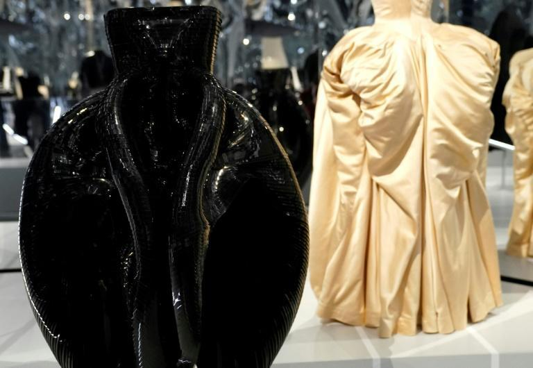 A piece from the designer Iris van Herpen, left, paired with another from Charles James