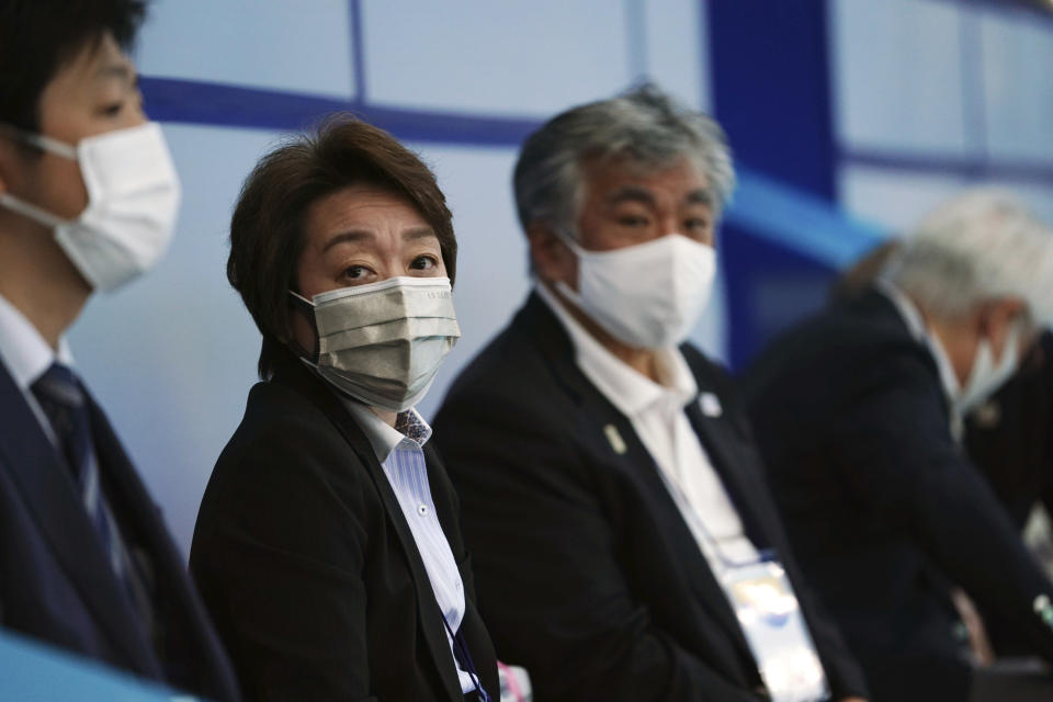 Tokyo 2020 Organizing Committee president Seiko Hashimoto observes the women's synchronized 3-meter springboard finals at the FINA Diving World Cup Saturday, May 1, 2021, at the Tokyo Aquatics Centre in Tokyo. (AP Photo/Eugene Hoshiko)