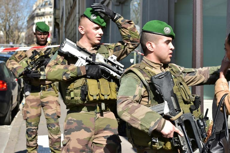 French troops on duty near the Paris offices of the International Monetary Fund on March 16, 2017